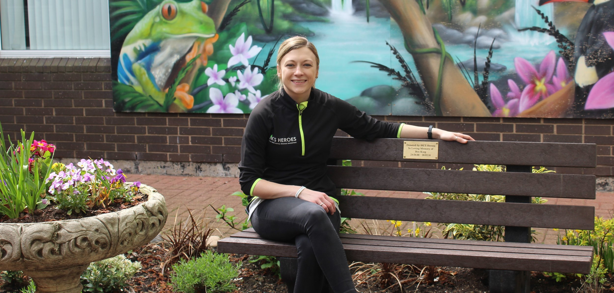 Dan, our newest member of the bk's heroes team visiting bens memorial bench in the sensory garden at preston royal hospital