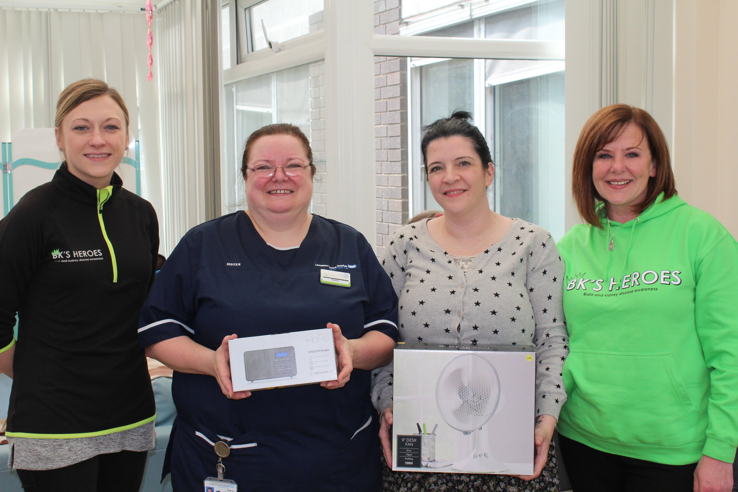 bk's heroes trustees fiona and dan handing over the fans and radios to the neuro ward sisters lisa and kathy