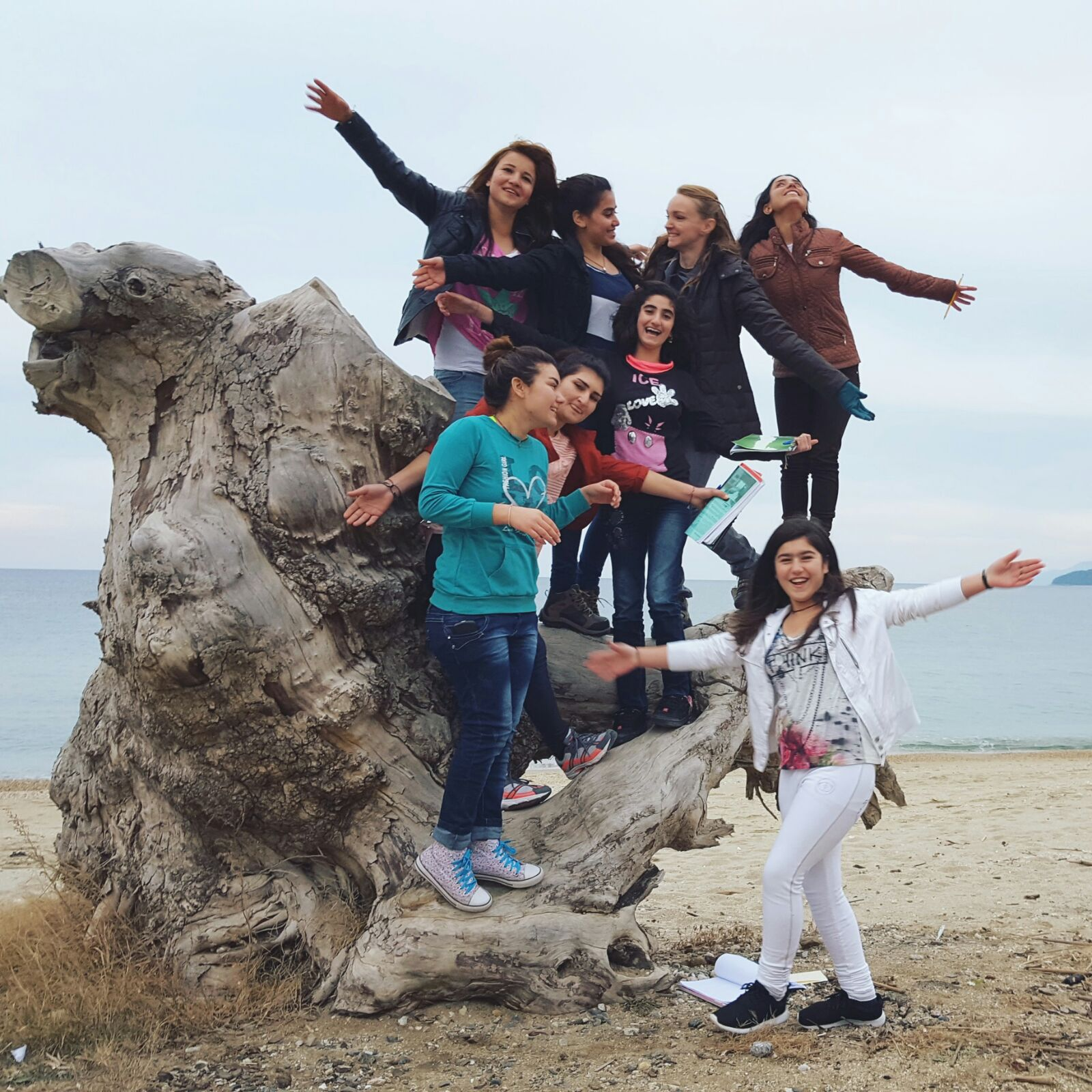 """After class one day, my Advanced English students and I decided to take a walk. Seeing these girls run so freely, laughing as they kicked up the sand behind them, was an image I never want to forget."""