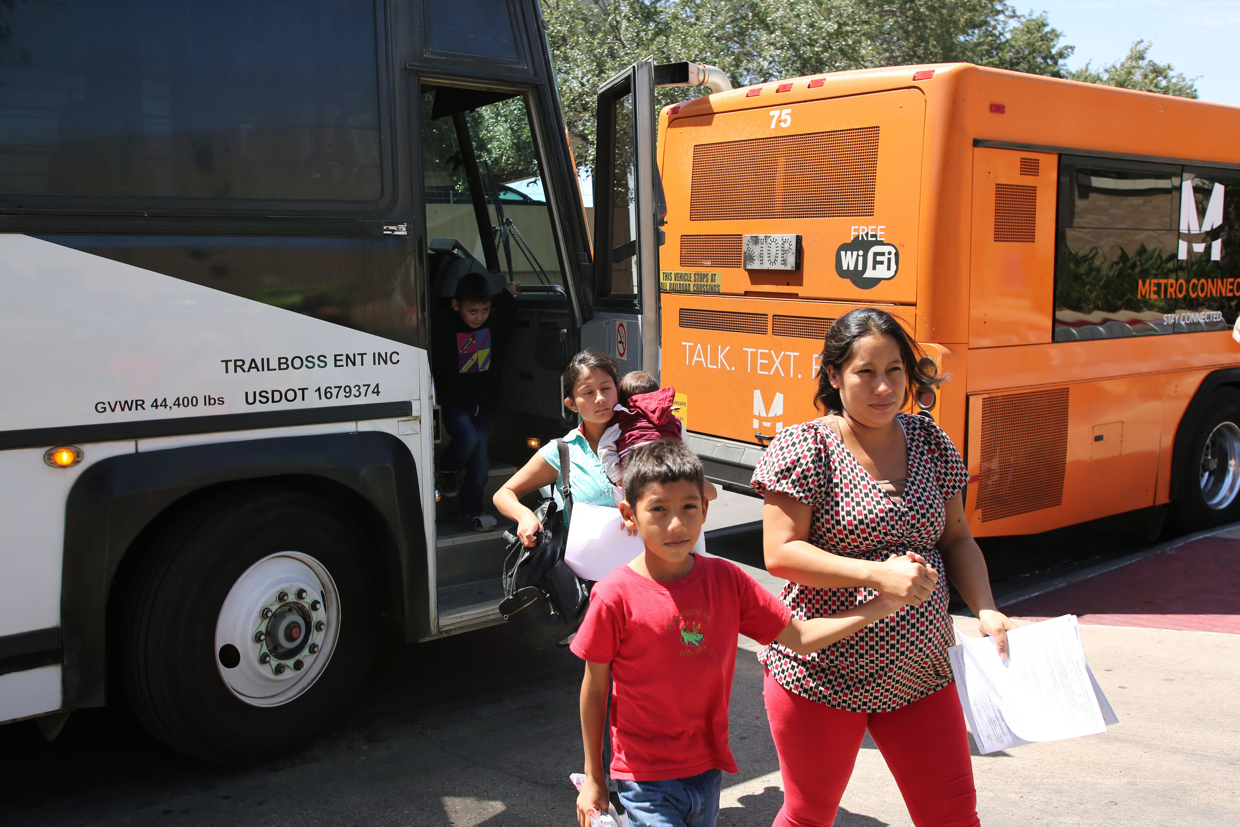 Central American families seeking asylum at our southern border get off a bus after being released from a detention center.