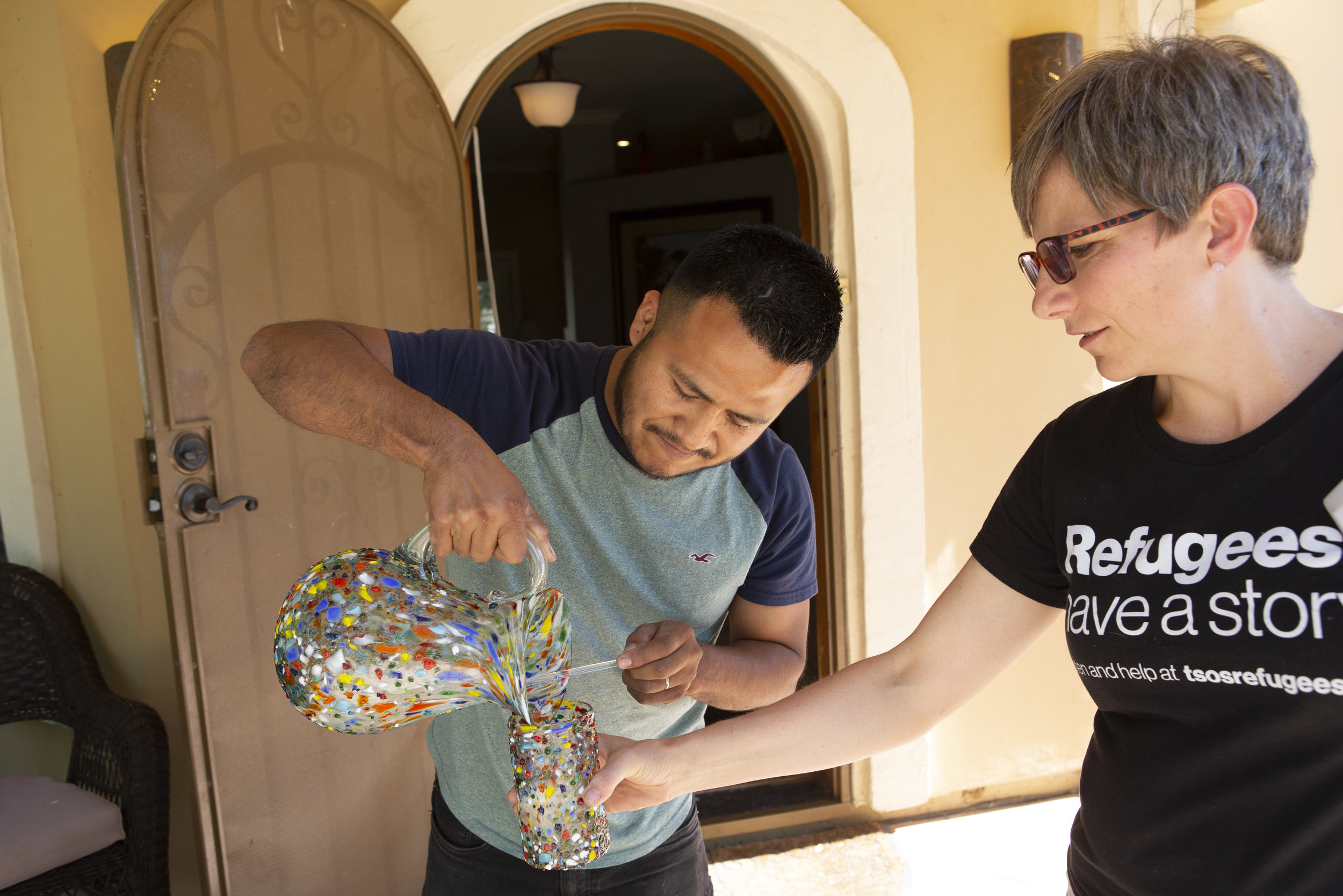 Israel pours lemonade for Megan Carson, from Their Story Is Our Story, when she interviewed him at his Arizona home.