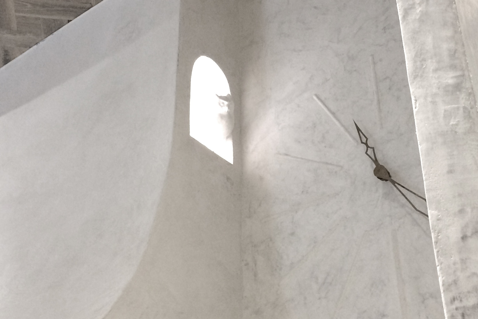Project: Limestone wall application and clock