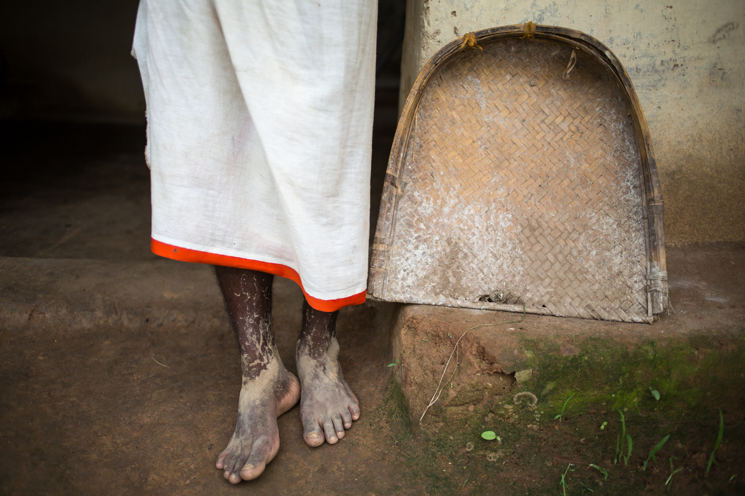 The well-oiled feet of a paddy farmer in Pedtali, a remote village in the forests of Mahan in Madhya Pradesh, INDIA.  The village might disappear if coal mining is allowed in the region to feed the many thermal power plants that have cropped.