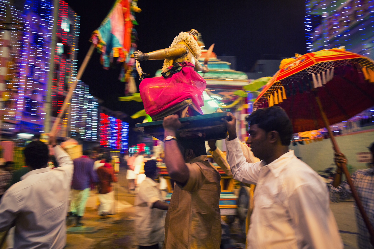 The first day of the Karaga begins with the hoisting of the flag and a procession of the temple idols. Seen here is the idol of a minor deity Potharaj, the brother-in-law of the Pandavas, being brought out. He wields a sword on his right hand and a goat in his left.