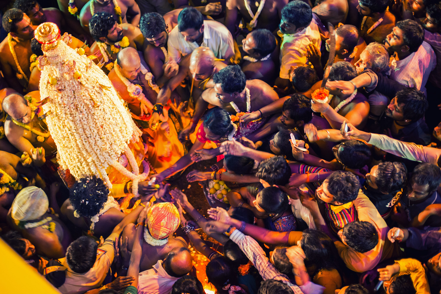 Considered extremely auspicious to receive a lemon from the hands of the Karaga bearer, there is always a mad scramble whenever the Karaga pauses momentarily to hand them out.