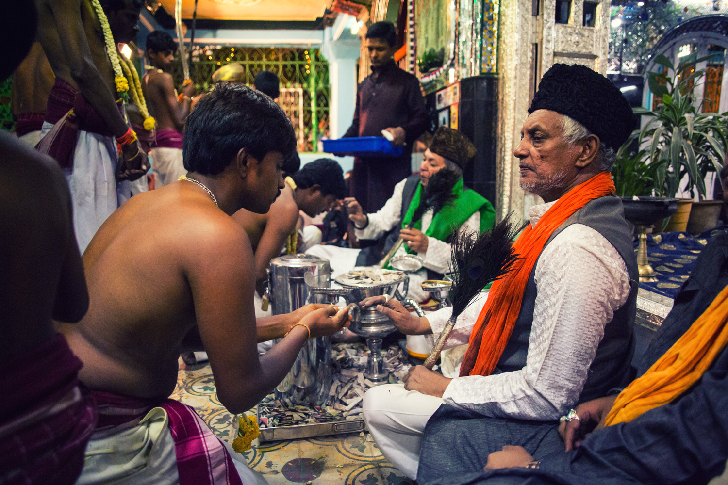 The uniqueness of the Bangalore Karaga is most certainly its secular spin. The Veerakumaras awaiting the arrival of the Karaga at the Dargah of Hazrat Tawakkal Mastan Shah receive blessings from Muslim clergy.