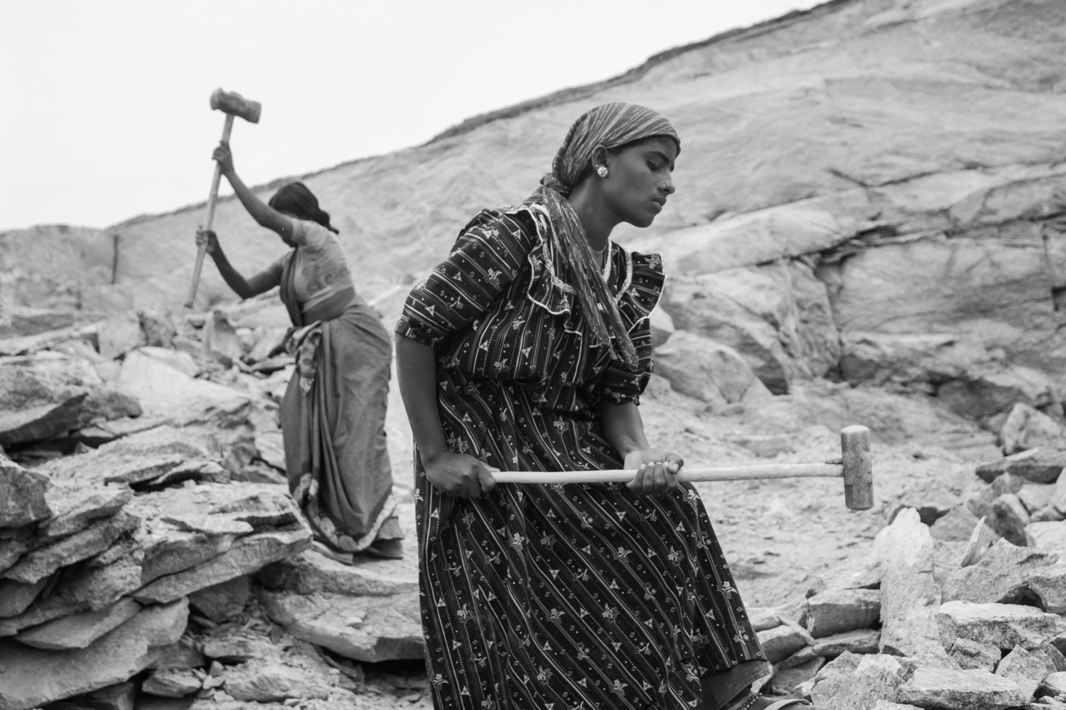 Women are a considerable force in the quarry primarily because of lower wages, although they do equal amount of work as men.