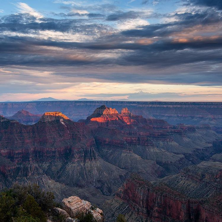 The sun sets over the North Rim of the Grand Canyon. © Robert Lowdon