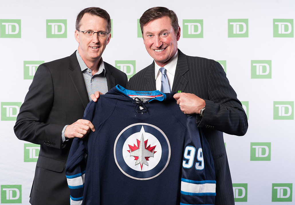 Wayne Gretzky and Mark Chipman pose for a photo at a large corporate event for TD Bank.