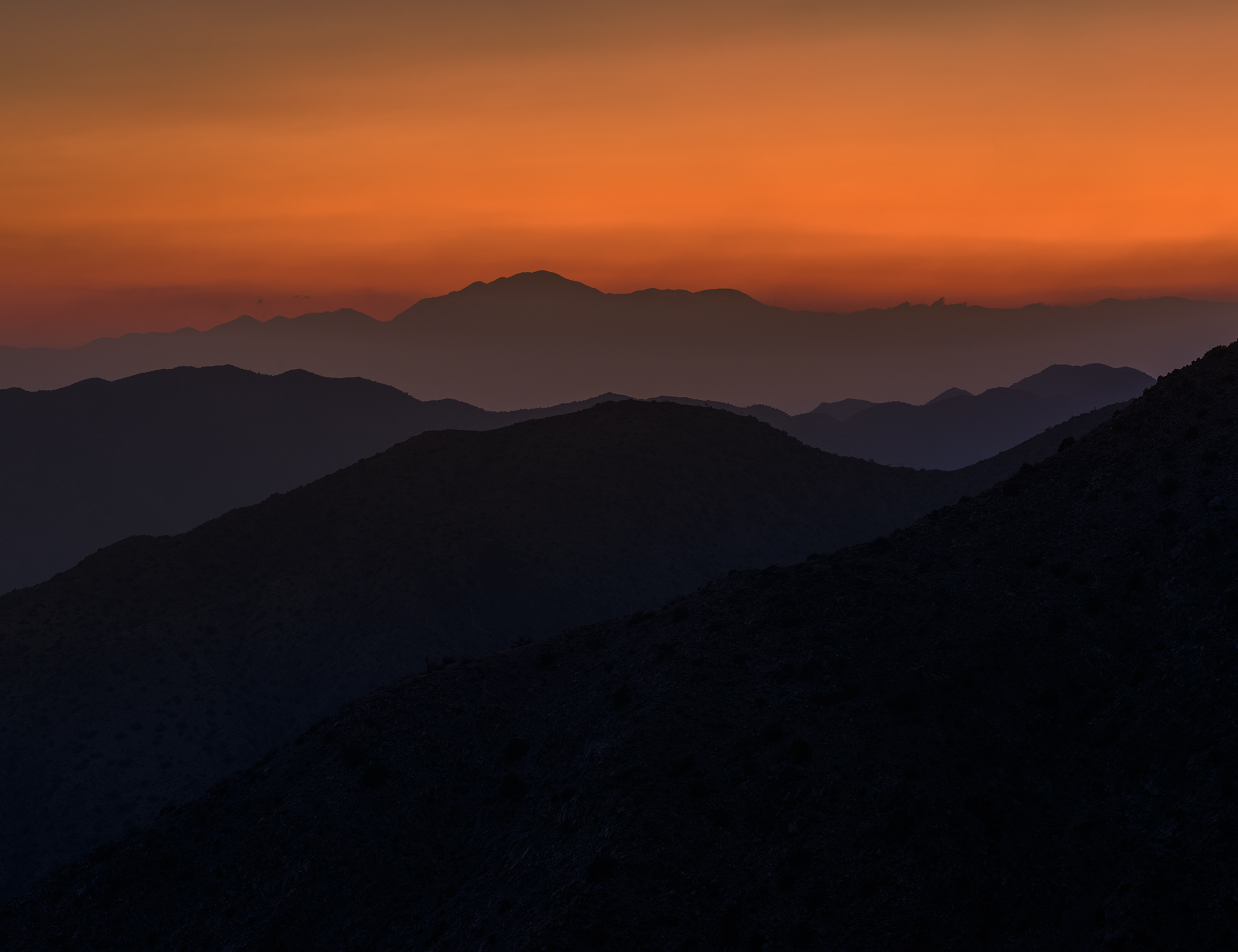 The sun sets over the San Jacinto mountains in California
