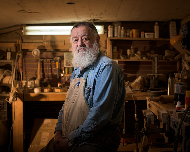 A woodworker poses for a photograph. © Robert Lowdon
