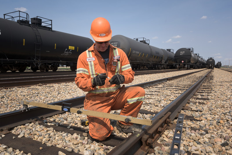 A worker inspecting the track. © Robert Lowdon