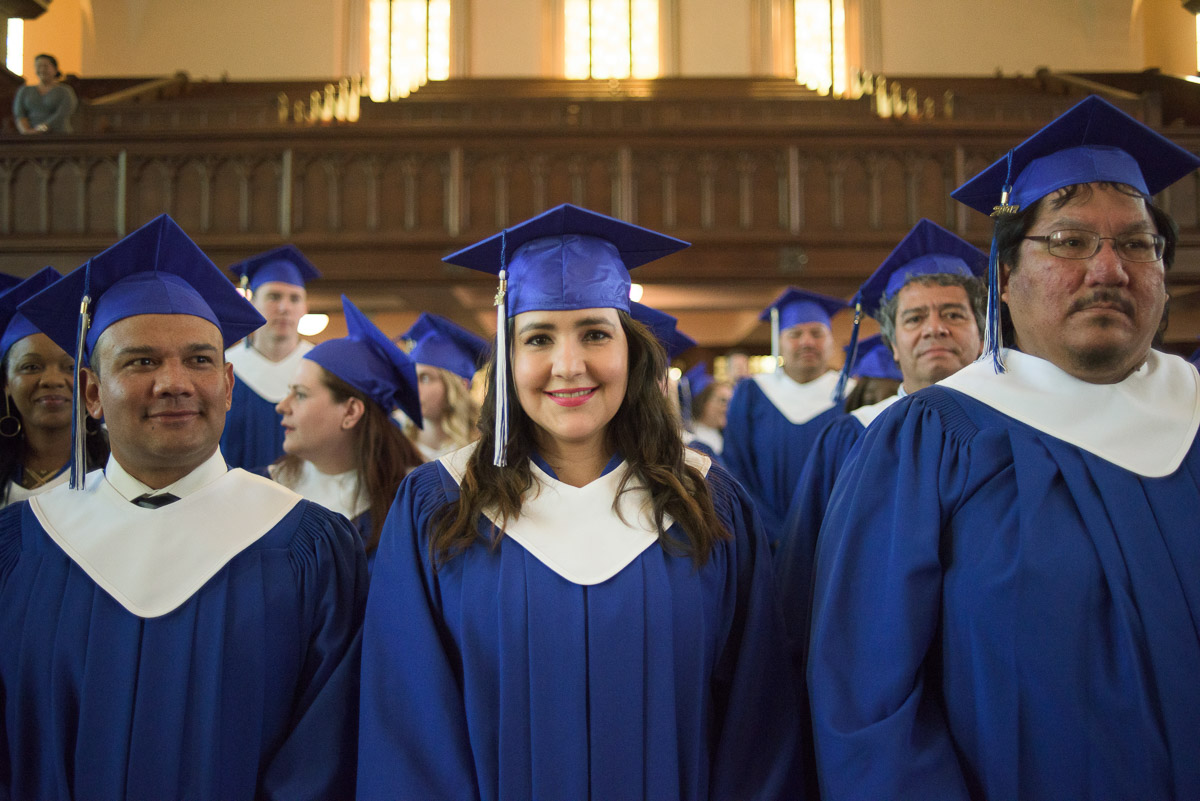 The students are front and centre in this medium close-up shot captured during the graduation ceremony.