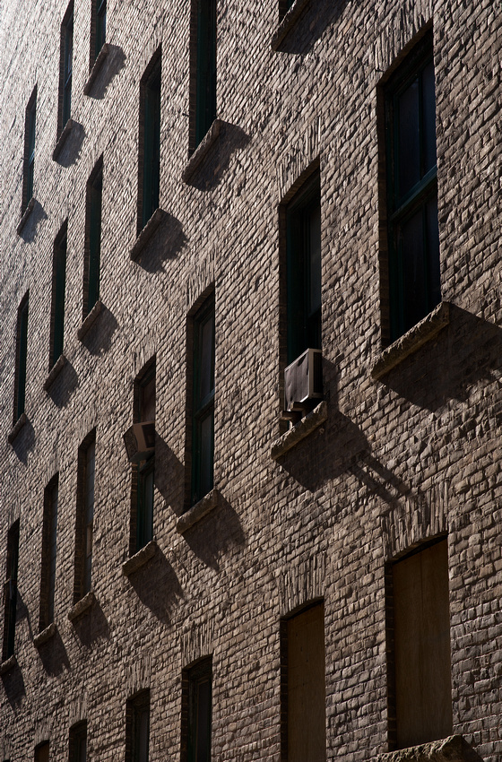 The side of an early 20th century building © Robert Lowdon  Bricks contain a lot of texture and capture so eloquently. In this image the sun is graciously giving some side lighting to this building, showing all of its beautiful textures.