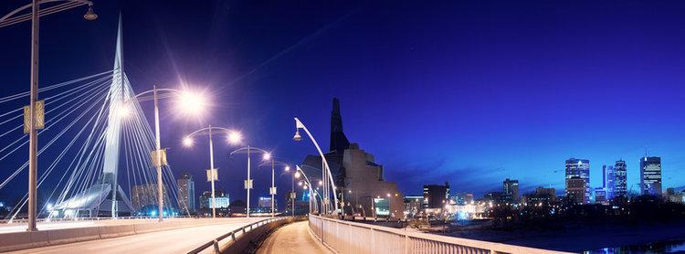 Walking Towards Winnipeg.  Photograph from the foot bridge on Esplanade Riel, Winnipeg MB