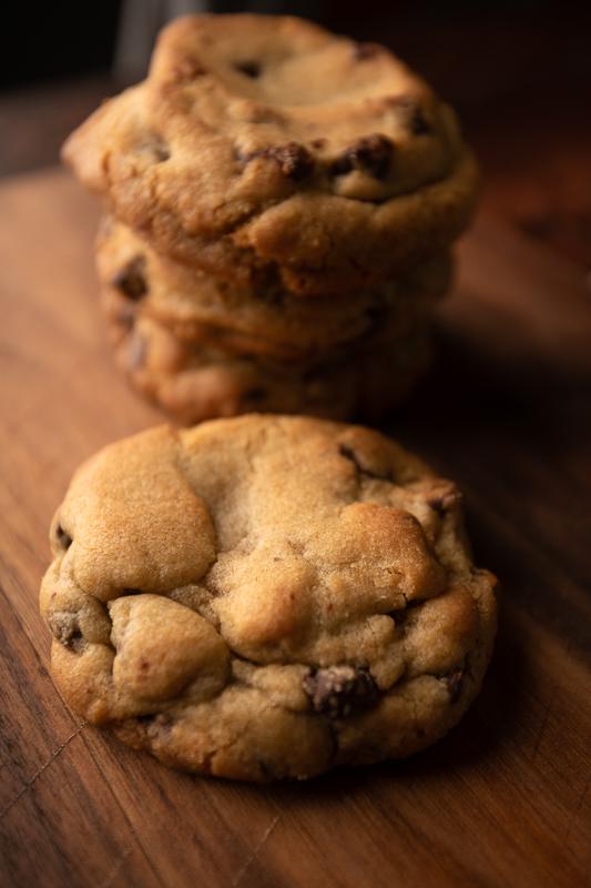 Cookies sit on a walnut board. © Robert Lowdon
