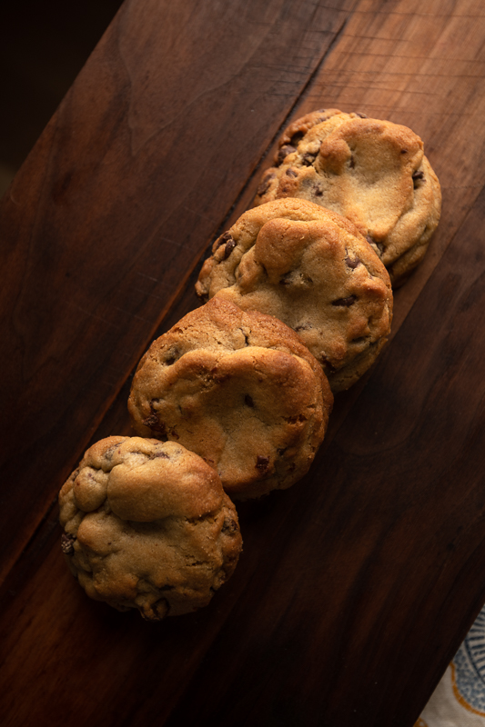 A closer in shot of the cookies on a board with the table cloth. © Robert Lowdon