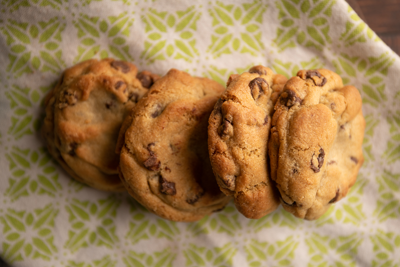A row of cookies on a cloth. © Robert Lowdon