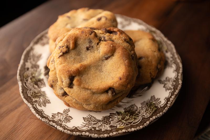 Three cookies on a small plate. © Robert Lowdon