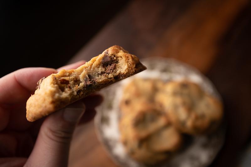 Hand holding the cookie. © Robert Lowdon