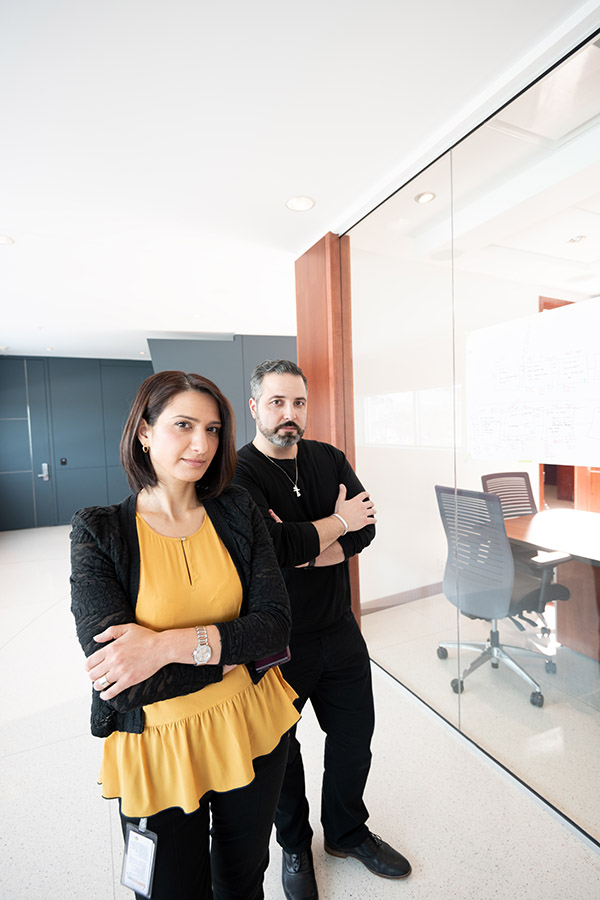 Two team members outside a boardroom