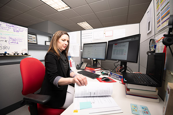 An employee working at her desk