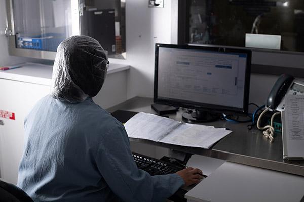 A researcher at a computer