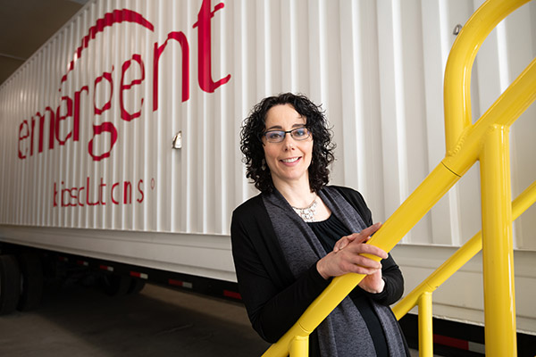 A casual portrait in front of a mobile laboratory.