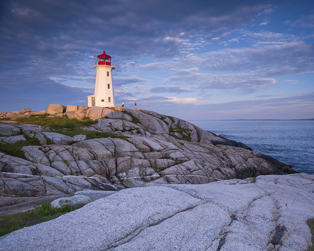 People outside the Lighthouse at Peggy's Cove. © Robert Lowdon