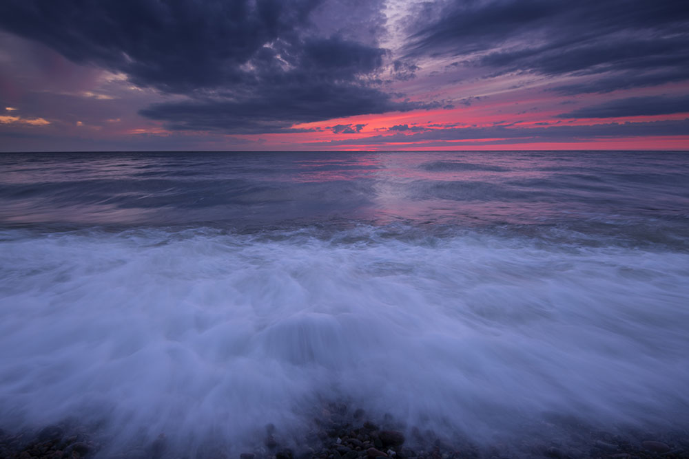Sunset on the Atlantic Ocean, off the Cabot Trail. © Robert Lowdon