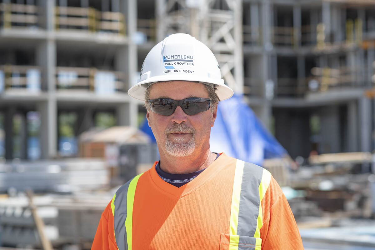 A construction Superintendent in front of a job site. © Robert Lowdon