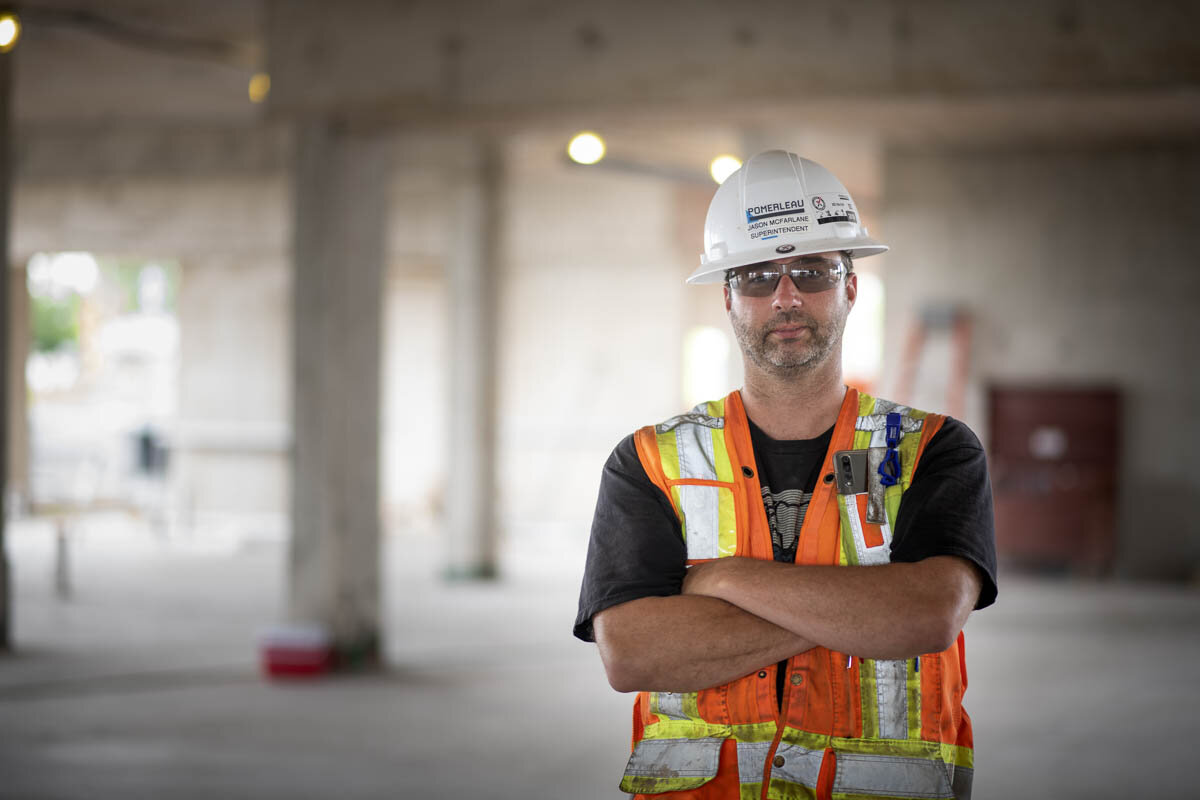 Superintendent of front of the job site.