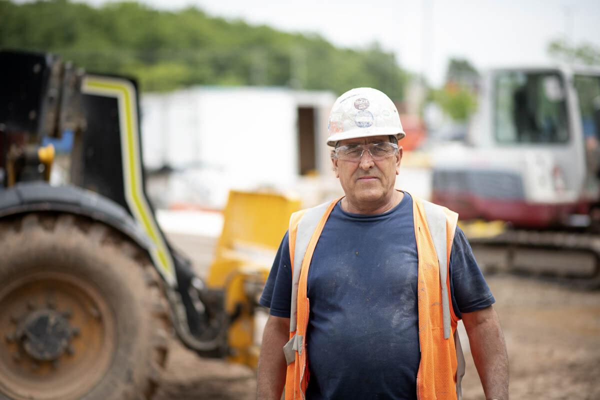A worker walks around large machinery. © Robert Lowdon