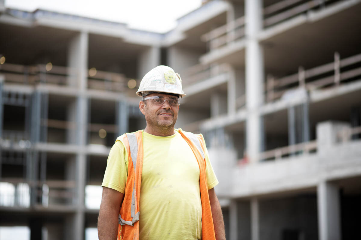 A worker in front of the new building. © Robert Lowdon
