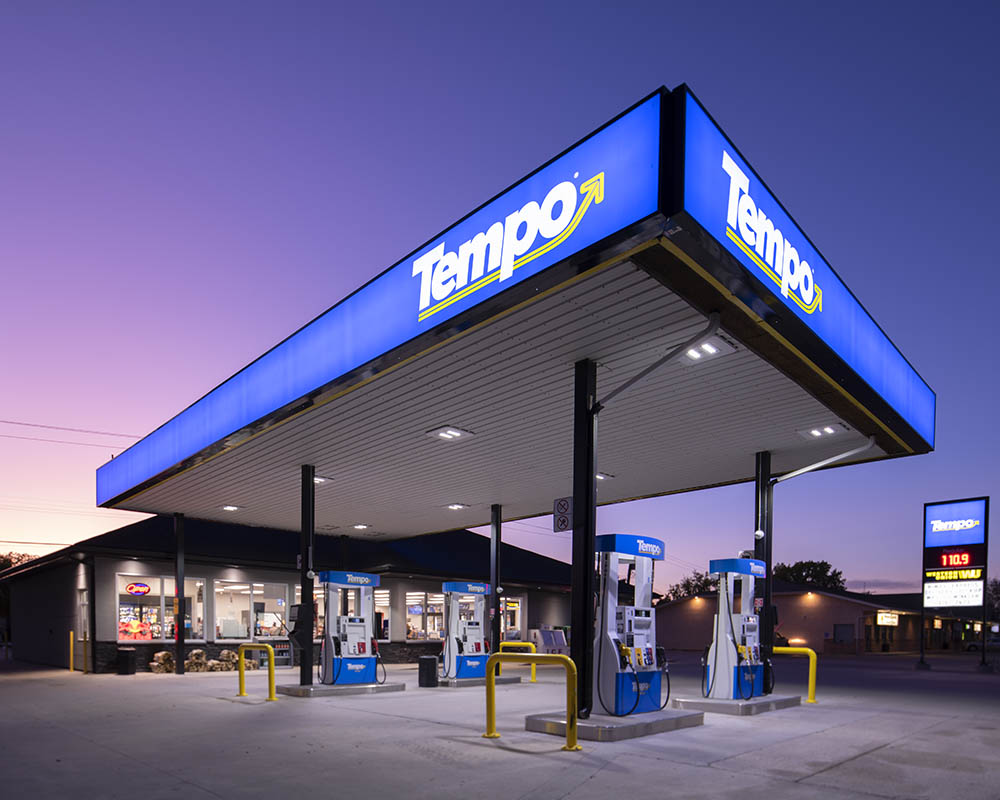 Just after sunset the sky glows purple over the gas station. © Robert Lowdon