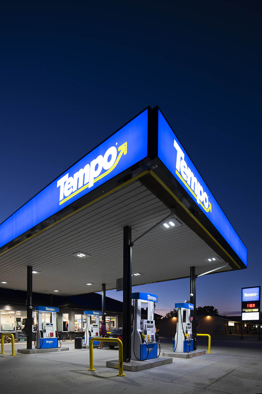 A vertical of the gas station at night. © Robert Lowdon