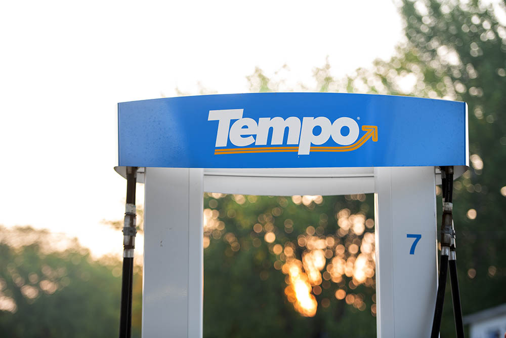 Close up of the Tempo logo on a pump with the sun rising in the background. © Robert Lowdon
