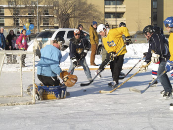 Students versus faculty hockey game at Brandon University on February 9, 2013. (Brady Knight / The Quill)