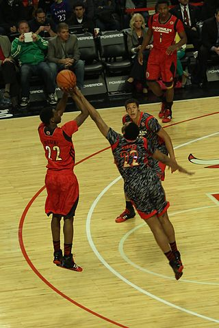 Andrew Wiggins (left) taking a shot during the 2013 McDonald's All-American Boys Game. (TonyTheTiger / Google Images Commons)