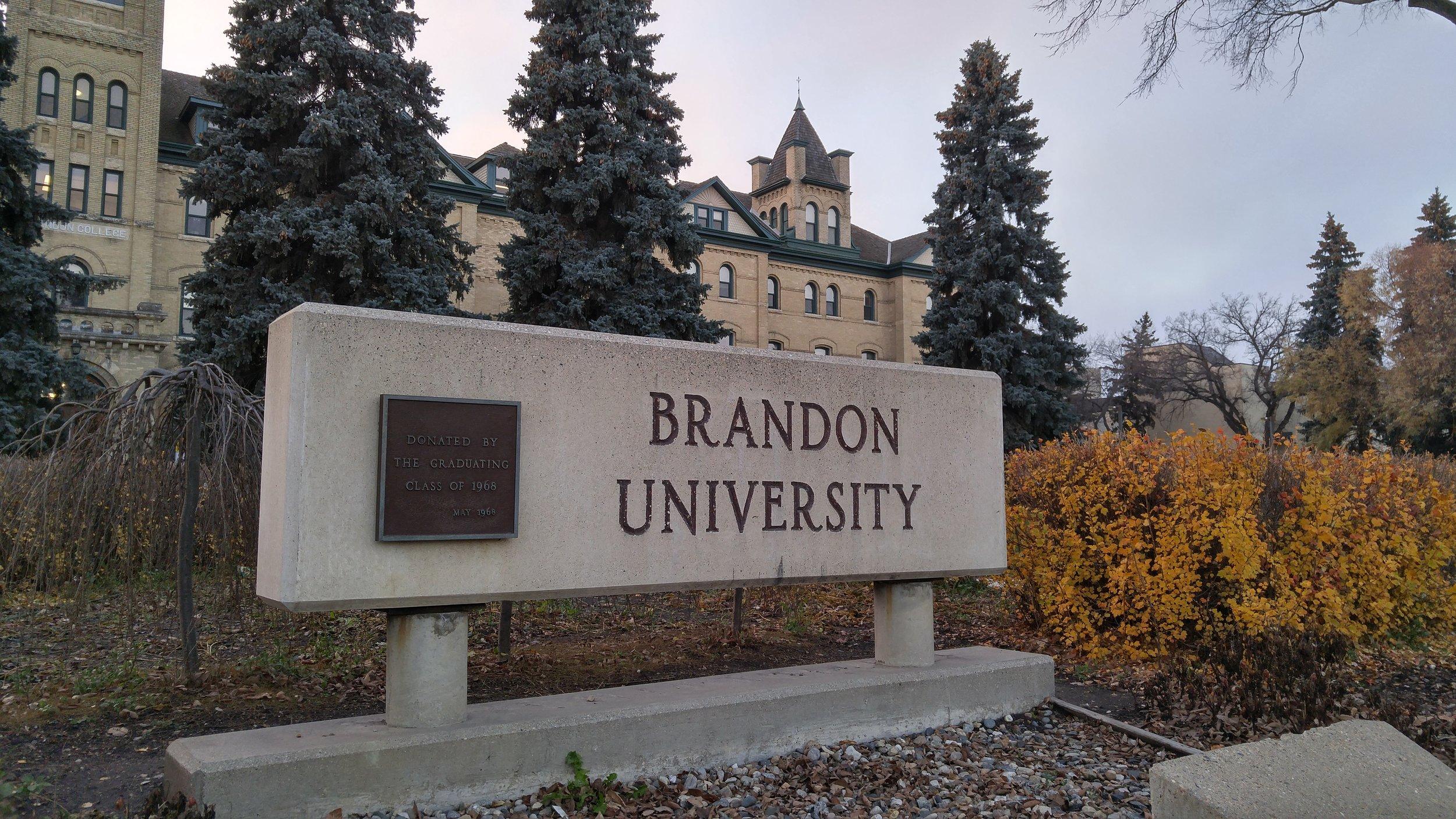 The Brandon University sign in front of Clark Hall. (Logan Praznik/The Quill)