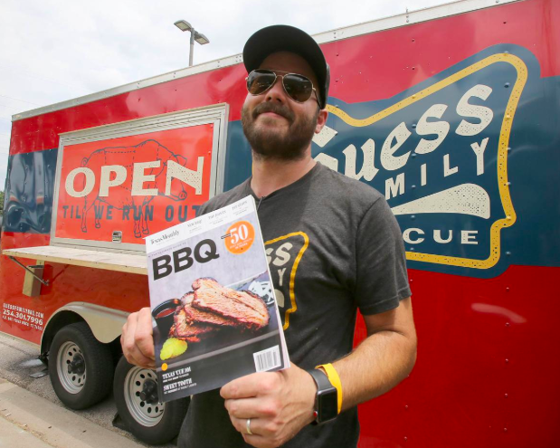 """Pitmaster Reid Guess holding a copy of the Texas Monthly magazine in which his pork spare ribs were named one of the """"Best Texas BBQ bites of 2017"""" by BBQ editor Daniel Vaughn. Photo: Jerry Larson, The Waco Tribune-Herald"""