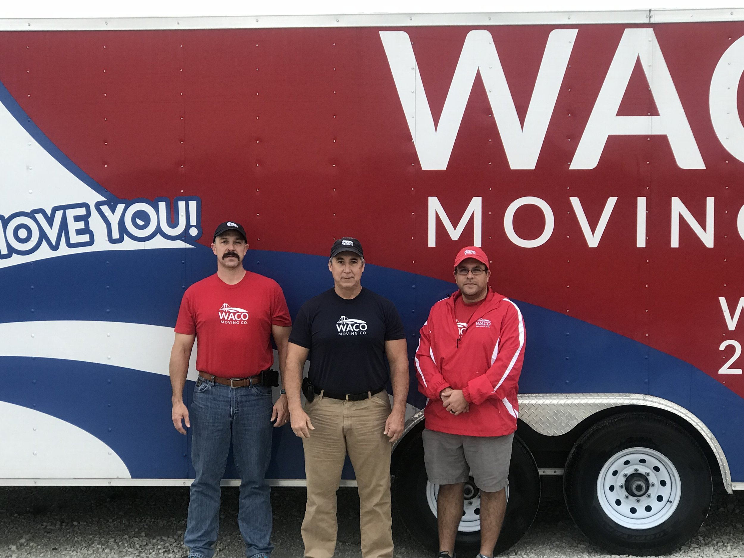 Lieutenant Robert Covey, Battalion Chief John Johnston, and Glen Farell of Waco Moving Company