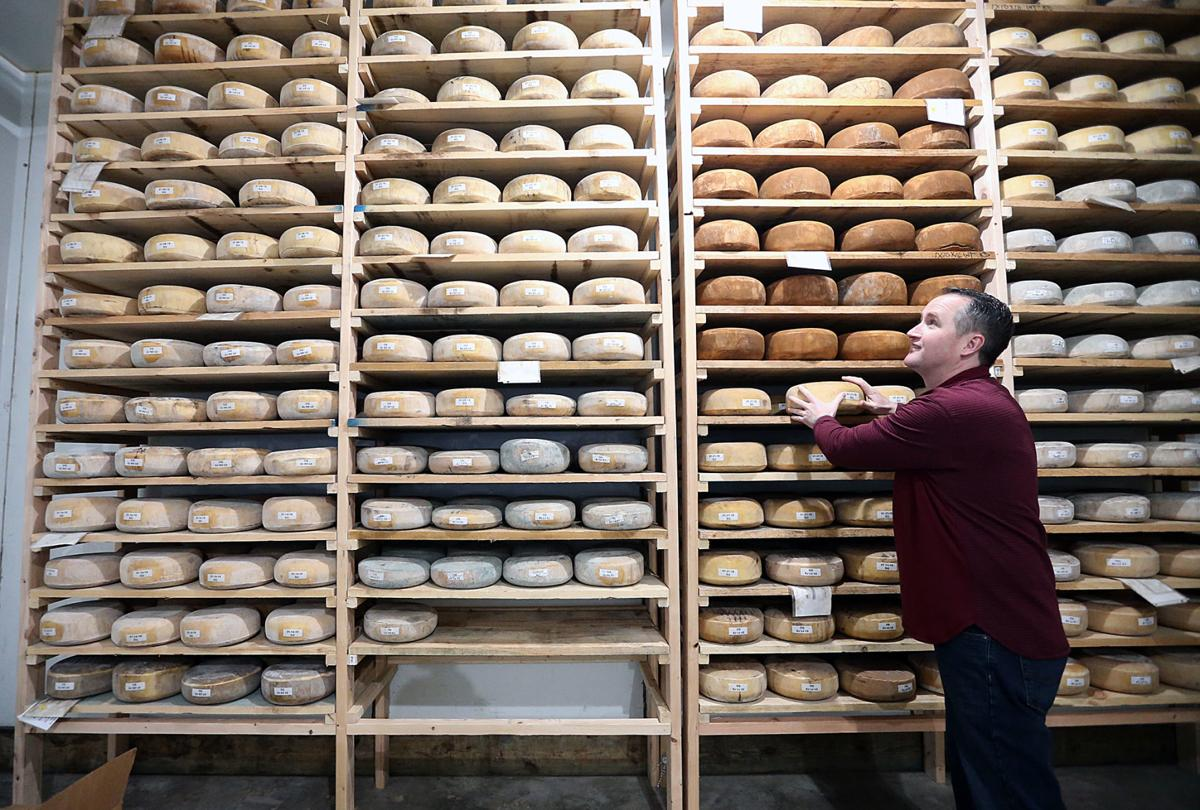 Brazos Valley Cheese co-founder Marc Kuehl looks over a wall of products at the company's new East Waco space, where it hopes to offer facilities for other food-related operations. The Waco-Tribune Herald; Staff photo - Rod Aydelotte