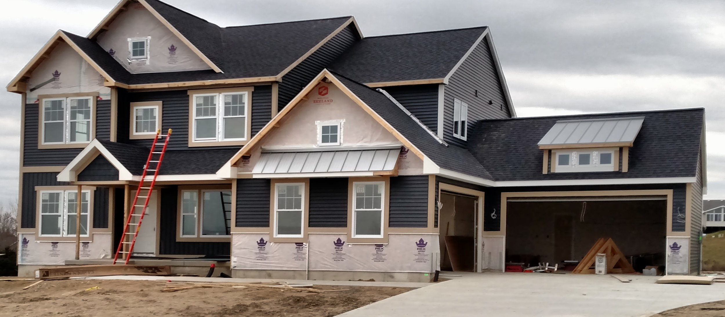Progress Shot of Home in Hudsonville, MI — American Classic Roofing &  Building Supply
