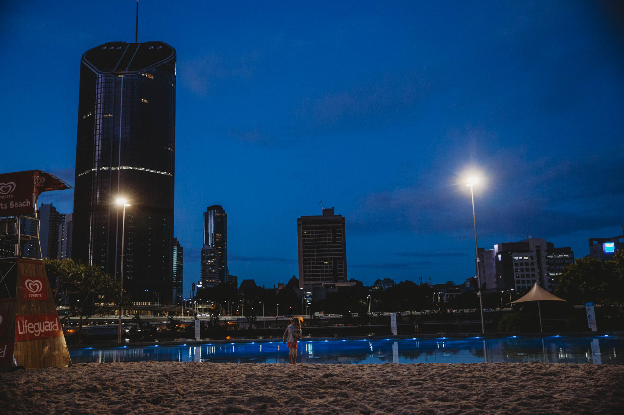 Nighttime play at the manmade city beach.