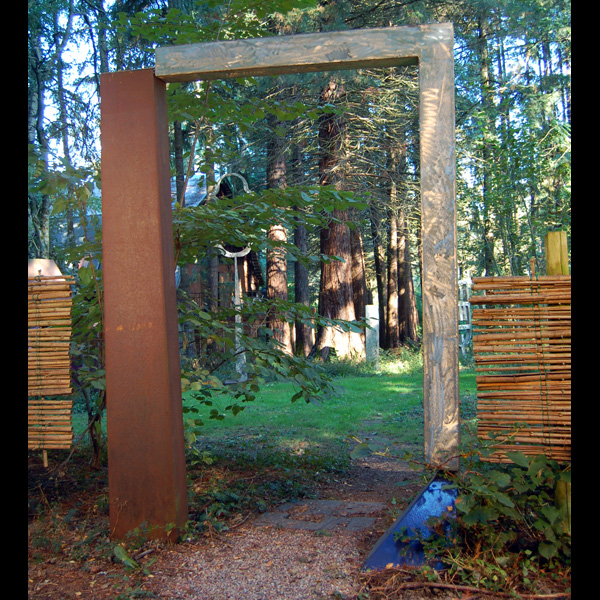 Borrowed Landscape  Mild steel, stainless steel and porcelain enamel gate with wooden fence. Sited at Leland Iron Works.