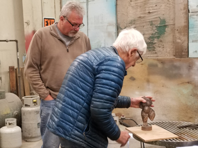 Lee Kelly and Blue Mountain Fine Art owner Tyler Fouts discussing the patina of Figure Study III.
