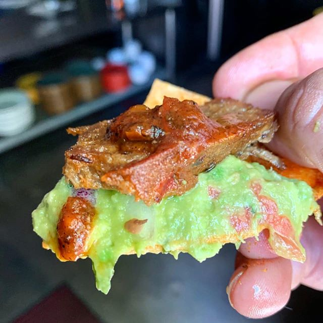 "Food tastes the best when it's made from scratch! ✌🏼❤🥦 Our house seitan makes the perfect ""carne asada"", fresh guacamole from carefully selected avocados, house salsa from charred farm fresh tomatoes, onions and peppers, and last, but not least, our non-GMO tortilla chip, made to order.  #vegano #vegan #vegansofinstagram #vegansofig  #compassionatecuisine #nachos  #guacamole #nongmo #seitan #whatveganseat #plantpower #"