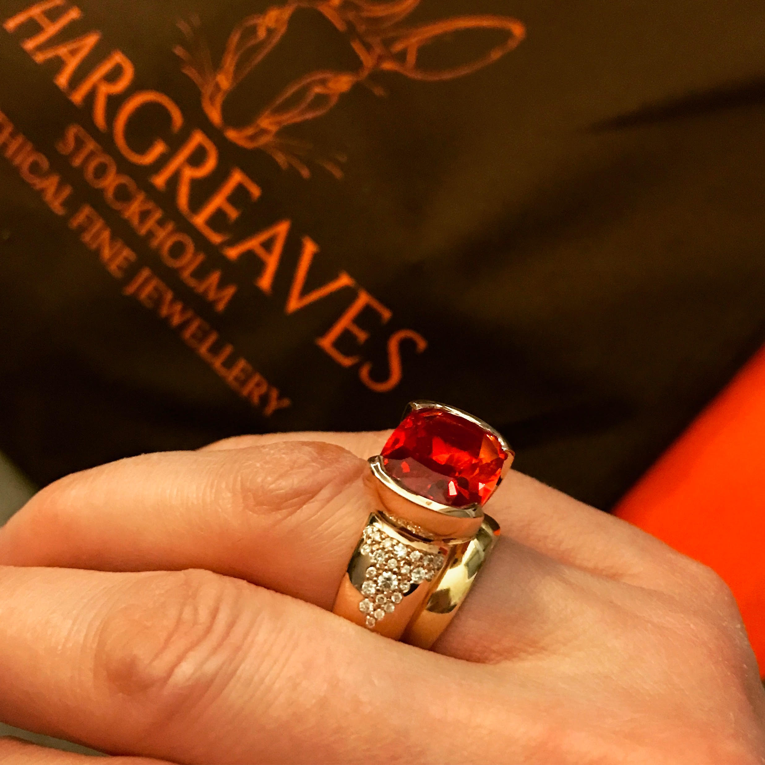 Our Freyr ring; 18ct red Fairmined Eco gold set with an incredible cultured bright orange sapphire and a cascade of non mined diamonds.