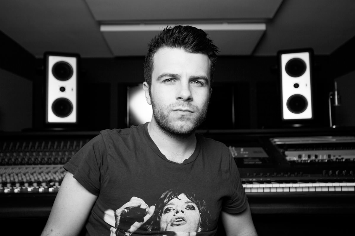 Matt Johnson sitting in his recording studio